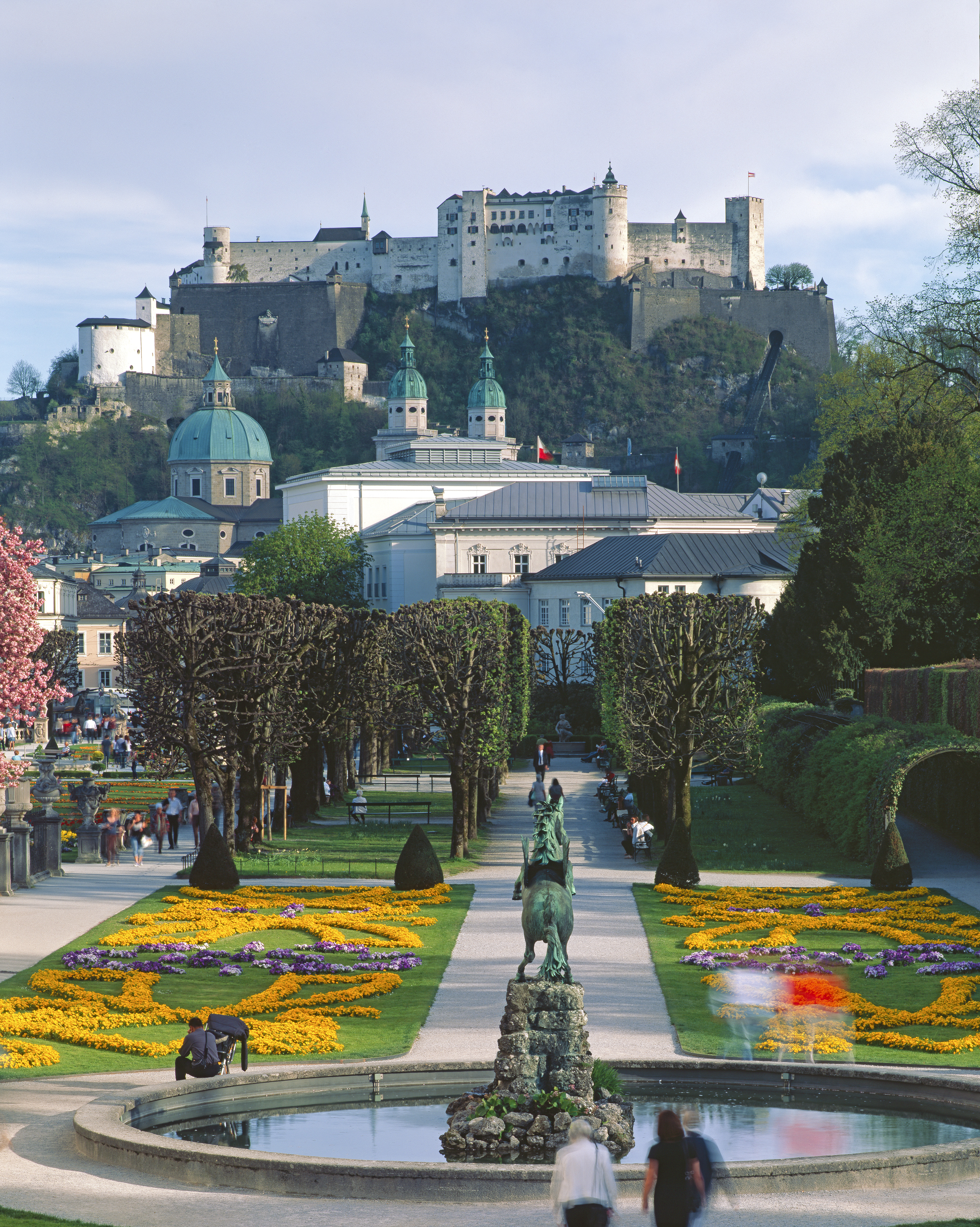 The medieval Hohensalzburg Fortress overlooking Mirabell Palace and Gardens in Salzburg